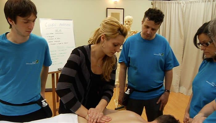 Teacher teaching massage therapy