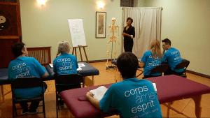 A massage teacher teaching anatomy.