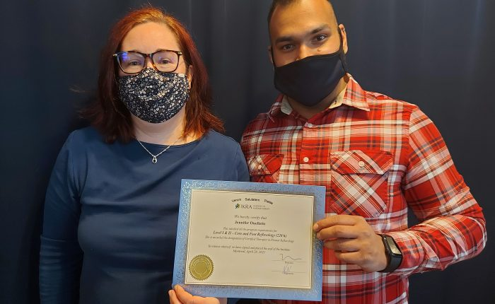 Jennifer Ouellette receives her diploma from IKRA Academy of Massage Therapy.