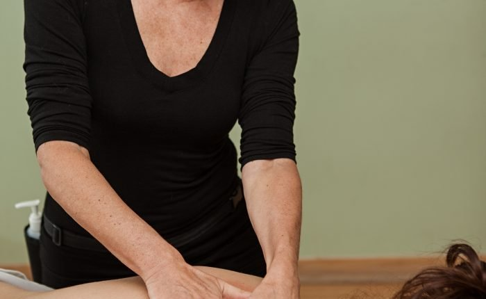 A great massage therapist Demonstrating a Masssage Technique.