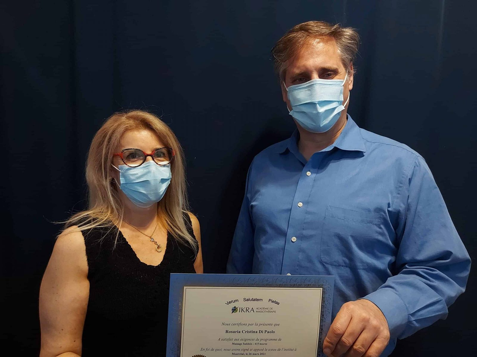 Rosaria DiPaolo receives her diploma from IKRA Academy of Massage Therapy