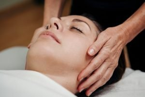 Student receiving a relaxation technique